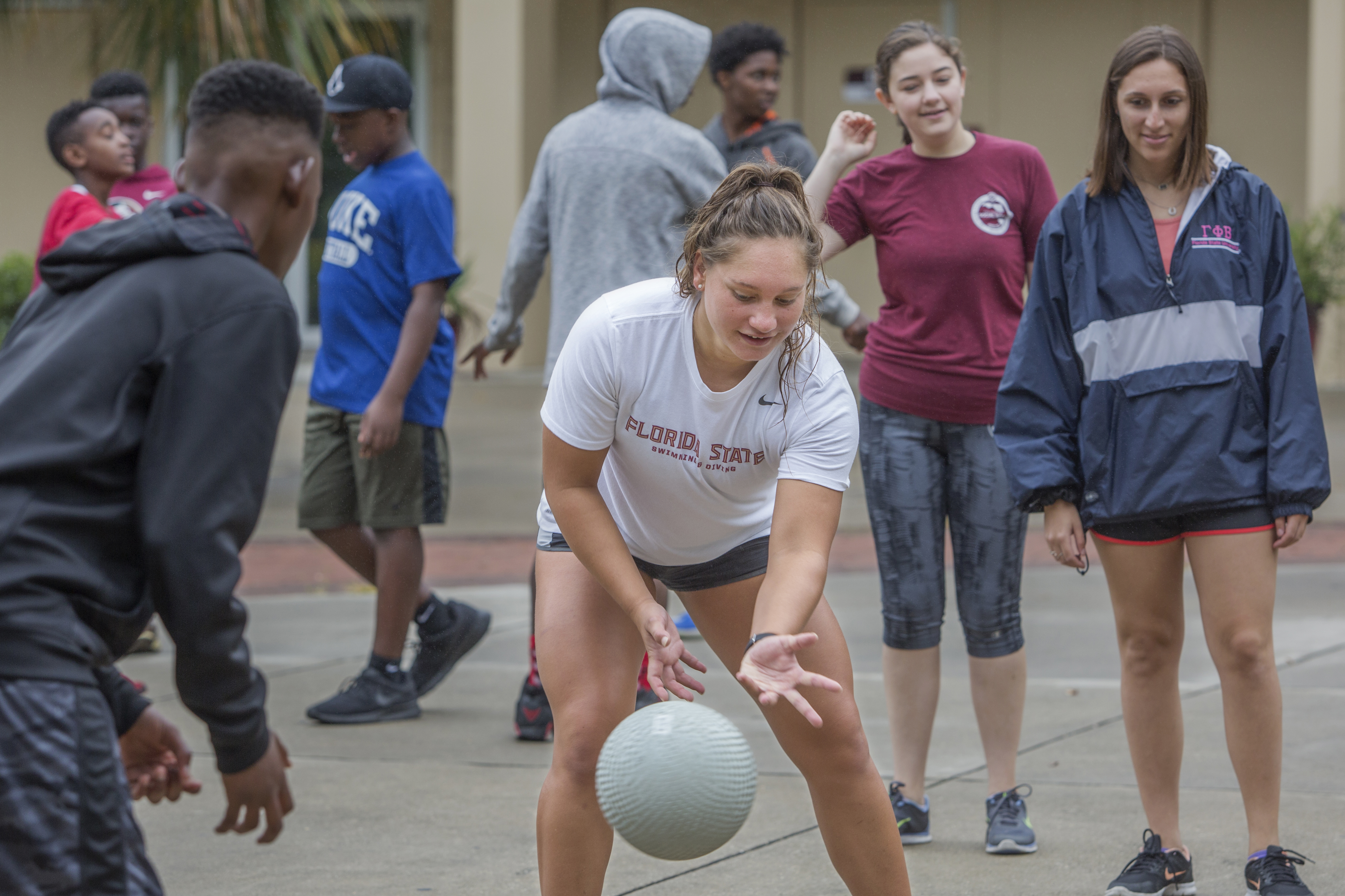 FSU Swimmer Paige Schendelaar-Kimp playing four square with campers.
