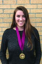 Hannon Kinnon with her Garnet and Gold Scholar Medal