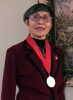 Amy L Ai wearing her American Academy of Social Work and Social Welfare medal